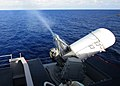 US Navy 050802-N-9907G-022 Smoke rolls down the barrels of the forward-starboard-mounted Phalanx Close-In weapons System (CWIS) as it tracks and fires at an aerial target drone.jpg