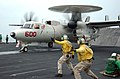 US Navy 051115-N-6484E-003 Two catapult shooters give the signal to launch an E-2C Hawkeye.jpg