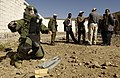 US Navy 051214-F-7234P-064 Yemen Explosive Ordinance Disposal (EOD) team members watch, U.S. Navy Petty Officer 2nd Class Frank Fazalore positions a device that will destroy a simulated Improvised Explosive Device (IED).jpg