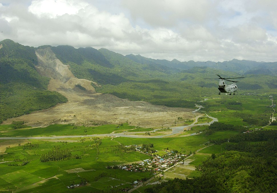 US Navy 060219-N-5067K-109 A CH-46E Sea Knight from the Flying Tigers of Marine Medium Helicopter Squadron 262 (HMM-262) makes an aerial assessment of the deadly Feb. 17 landslide during over-flight of the area