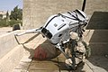 US Navy 061103-M-7387J-001 U.S. Marines from Fox Company 2nd platoon 3rd squad secure the site of an unmanned aerial vehicle which crash landed on the roof of a house in the city of Hadithah while recovery issues are organized.jpg