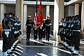 US Navy 061117-N-6544L-005 The Marine Corps color guard assigned to the American Embassy in Tunis marches past a corridor of Tunisian honor guards while retiring the colors during a wreath-laying ceremony at the North African A.jpg