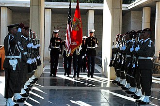 North Africa American Cemetery and Memorial - Image: US Navy 061117 N 6544L 005 The Marine Corps color guard assigned to the American Embassy in Tunis marches past a corridor of Tunisian honor guards while retiring the colors during a wreath laying ceremony at the North African A