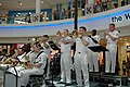 US Navy 070304-N-2468S-001 Members of the 7th Fleet band perform during a free public concert held at Curve Mall in Kuala Lumpur, Malaysia.jpg