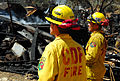 US Navy 070511-N-4774B-236 Firefighters assigned to the California Department of Forestry and Fire Protection (CDF) survey the remains of a business on Catalina Island that was ravaged by a wildfire.jpg