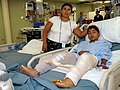 US Navy 070731-N-4238B-014 A young boy and his mother pose for a photo in the intensive care unit aboard hospital ship USNS Comfort (T-AH 20), while he recovers after a surgery on his legs.jpg