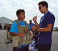 US Navy 080722-N-2888Q-007 Explosive Ordnance Technician Bobby Wood, right, talks with a young boy wearing an EOD 9 bomb disposal suit during Healthy Kids Day at the Delaware State Fair.jpg