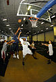 US Navy 081012-N-7780S-007 Cryptologic Technician (Technical) 2nd Class Terrence Burrell, from Houston, Texas, attempts to block Seaman Elzer Bailes from Chicago, during a basketball game in the hangar bay aboard the Nimitz-cla.jpg