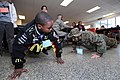US Navy 090221-N-5328N-119 A West Pensacola Elementary School Saturday Scholar student, who says he wants to become a Marine, does push ups with Saturday Scholar mentor Pfc. Kayla McCracken, from Longview, Texas.jpg