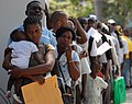 US Navy 090410-N-6259S-001 Haitians queue to be screened for medical treatment by physicians embarked aboard the Military Sealift Command hospital ship USNS Comfort (T-AH 20) during a Continuing Promise 2009 medical community s.jpg