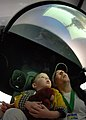 US Navy 090418-N-8726C-003 Brad Wyckhouse and his two-year-old son stare in awe at the Accelerate Your Life simulator at Forest Park during a St. Louis Navy Week display at Forest Park in St. Louis.jpg