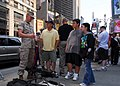 US Navy 090523-N-5681S-006 Lance Cpl. Dustin Phillips, from West Salem, Ohio stationed at Camp Le Juene, N.C., demonstrates military equipment to civilians during USMC Day in Times Square.jpg