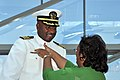 US Navy 090626-N-4134D-050 Capt. Gary Edwards, commanding officer of the Center for Information Dominance, Corry Station receives his command ashore pin from his wife at the conclusion of a June 26 change of command ceremony.jpg