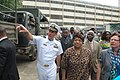 US Navy 090904-N-8138M-002 Cdr. John D. Tolg President of Liberia Ellen Johnson, and Brooks A. Robinson trucks loaded with 24 pallets of Project Handclasp donations.jpg