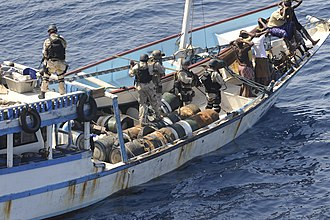 Visit, board, search, and seizure - Image: US Navy 091112 N 9500T 170 Members of a visit, board, search and seizure team from the guided missile cruiser USS Chosin (CG 65) keep watch over the crew of a suspected pirate dhow