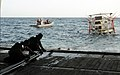 US Navy 091121-N-1291E-251 Sailors from Helicopter Mine Countermeasures Squadron (HM) 15 help pull in a MK-105 Mod 4 Sled, used for mine countermeasures.jpg