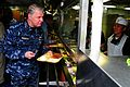 US Navy 100106-N-9760Z-053(1) Chief of Naval Operations (CNO) Adm. Gary Roughead goes through the mess deck line before having dinner with Sailors aboard USS Nimitz (CVN 68).jpg