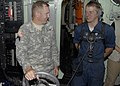 US Navy 100228-N-2000D-162 Lt. Gen. P.K. (Ken) Keen, commander of Joint Task Force Haiti, talks with Seaman Andrew Plagge, from Fort Dodge, Iowa, in the pilothouse of the amphibious dock landing ship USS Carter Hall (LSD 50).jpg