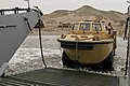 US Navy 100707-N-5319A-030 Boatswain's Mate Seaman Ashleigh Brown drives a lighter amphibious re-supply cargo (LARC) vehicle, assigned to Beach Master Unit (BMU) 1, off of Salinas Beach, Peru onto Landing Craft Unit (LCU) 1617.jpg
