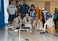 US Navy 110121-N-3570S-230 Sailors, parents and Cub Scouts watch the winning car draw near the finish line at Cub Scouts Pack 23's Pinewood Derby a.jpg