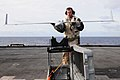 US Navy 110226-N-RC734-107 Jon Wingard, a Scan Eagle operator and maintainer from Insitu Group, places an Scan Eagle unmanned aerial vehicle on it.jpg