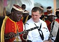 US Navy 110421-N-NY820-053 U.S. Fleet Forces Band member Musician 3rd Class Fred Vaughan talks with a Jamaican Defense Force Band member during the.jpg