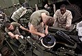 US Navy 110510-N-QP268-319 Marines perform routine maintenance on an M777 A2 Howitzer aboard USS Whidbey Island (LSD 41).jpg
