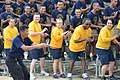 US Navy 110519-N-VA590-271 U.S. and Royal Thai Navy sailors perform a cheer during a soccer match at Nong Prue Municipality Sports Field.jpg