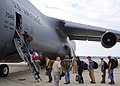 US Navy 110724-N-BM186-051 Sailors assigned to Explosive Ordnance Disposal Mobile Unit (EODMU) 11 board a C-5 Galaxy transport aircraft for Bahrain.jpg
