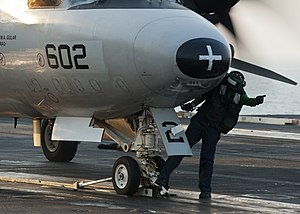 US Navy 111218-N-BT887-057 A Sailor gives the signal to add tension to the catapult to launch an E-2C Hawkeye assigned to the Golden Hawks of Airbo.jpg