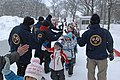 US Navy 120203-N-ZI955-106 Members of the Navy Misawa snow sculpture team give high-fives to a group of local school children visiting their sculpt.jpg