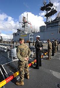 US Navy 120214-N-MJ645-102 Sailors and Marines aboard USS Bonhomme Richard (LHD-6) man the rails as the ship leaves San Diego.jpg
