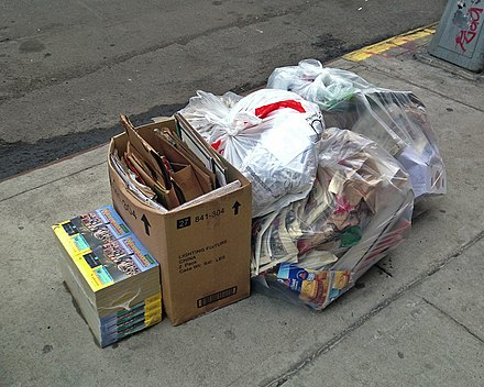 Recently delivered 2013-2014 phone books in the trash unopened. In the 21st century some communities have tried to stop the unsolicited distribution of the books Unused Phonebooks.JPG