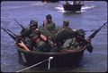 Vietnam....U.S. Marines, grouped in fours and fives in outboard motor boats, approach the beach in an amphibious... - NARA - 558508.tif
