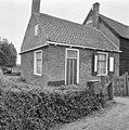 Voor- en zijgevel woonhuis - Vrouwenpolder - 20247770 - RCE.jpg