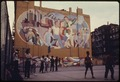 WALL PAINTING IN HELL'S KITCHEN OF MANHATTAN, NEW YORK CITY FORMS A BACKDROP TO AN INNER CITY PLAYGROUND FOR AREA... - NARA - 555935.tif