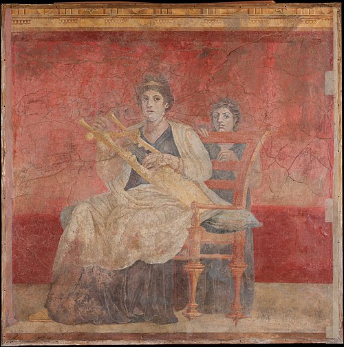 A seated woman in a fresco from the Roman Villa Boscoreale, dated mid-1st century BC. It likely represents Berenice II of Ptolemaic Egypt wearing a stephane (i.e. royal diadem) on her head. Wall painting from Room H of the Villa of P. Fannius Synistor at Boscoreale MET DP105943.jpg