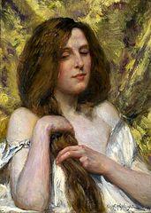 A woman plaiting her hair.