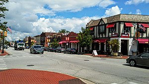 Highwood, Illinois - Waukegan Avenue, a main thoroughfare in the Business District, is lined with shops and restaurants with outdoor cafes in summer. August 2017.