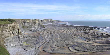 Wave cut platform caused by erosion of cliffs by the sea, at Southerndown in South Wales Wavecut platform southerndown pano.jpg