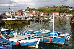 Whitby harbour overlooked by the Abbey ruins on the skyline.