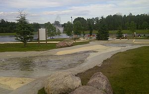 Whitecourt - The Whitecourt River Slides overlooking the pond and fountain in Rotary Park