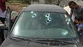 Windshield hit by sponge grenade Ni'lin March 2016.jpg