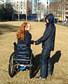 Woman in wheelchair holding hands.jpg
