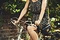 Woman wearing watch on bike (Unsplash).jpg