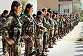 YPJ soldiers with their rifles stand in formation.jpg