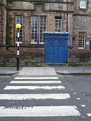 Crosswalk with simple white parallel lines in Edinburgh