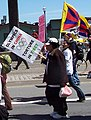 """OLYMPICS IN CHINA TORTURE IN TIBET"" AND ""SAVE TIBET NOW"" with flag of Tibet detail, Olympics torch protest (2417352003) (cropped).jpg"