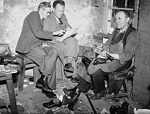 (Evan Jenkins and David Jones, two folk poets from Ffair Rhos, discussing their poems in a cobbler's workshop) (6346726249).jpg