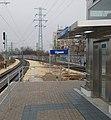 Újpest train station, semaphore, station name sign, electricity pylon and lift, 2019 Angyalföld.jpg